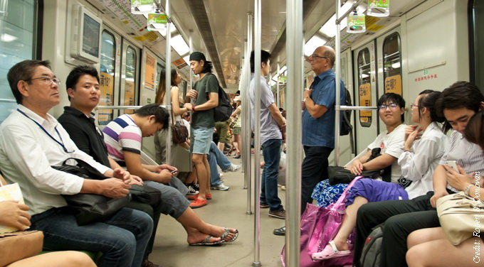 people riding shanghai subway