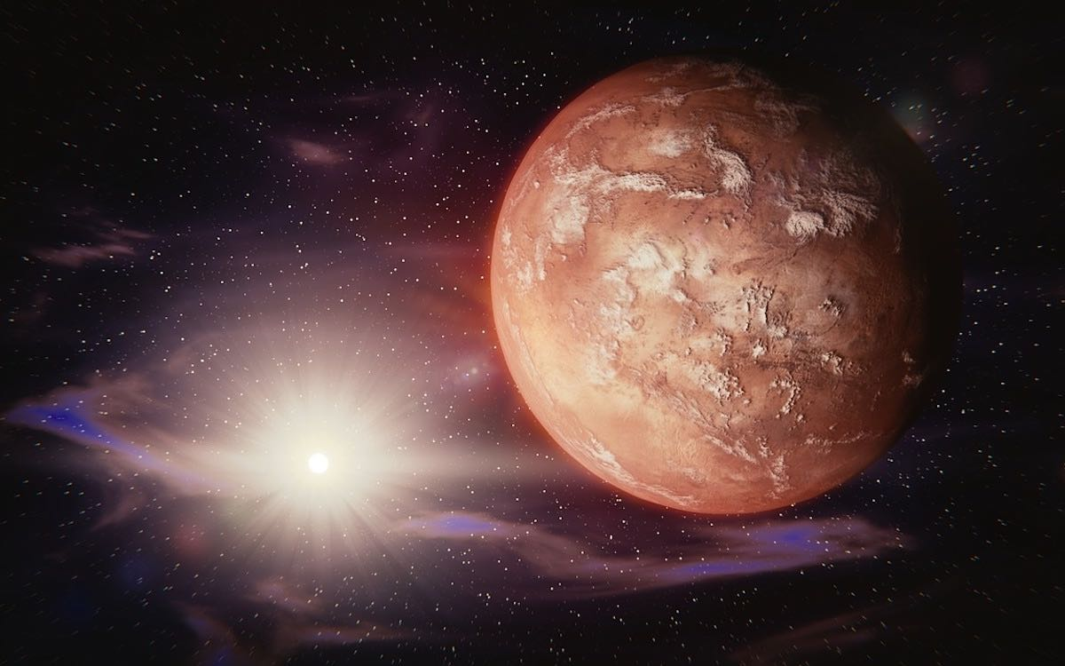 The image shows the Red Planet bathed in the glow of sunlight. China aims to win the new space race with missions to Mars.