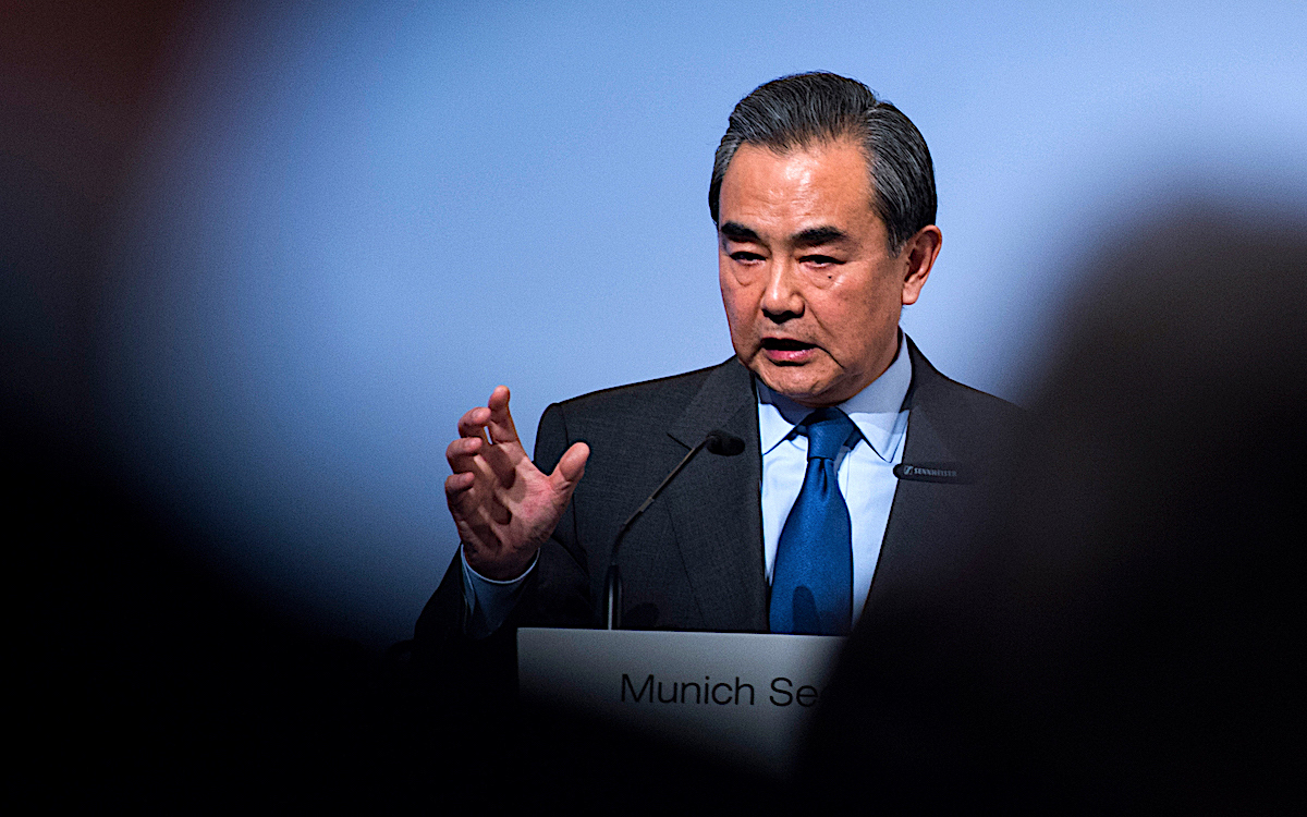 The photo shows Foreign Affairs Minister Wang Yi bathed in shadow. He has been at vanguard of applying pressure on the US.