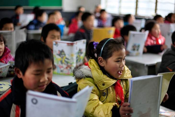 Children of migrant workers attend a class at a primary school in Shanghai