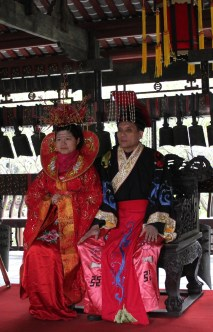 Chinese couple dress up in costumes