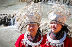 Chinese tourists dress up in Naxi costumes.