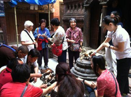 7 Butter Lamp Offering at MahaBuddha Stupa