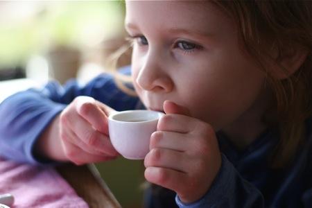 little-girl-drinking-tea