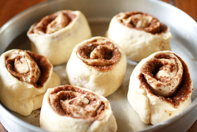 Homemade, Fluffy Cinnamon Rolls in a round pan