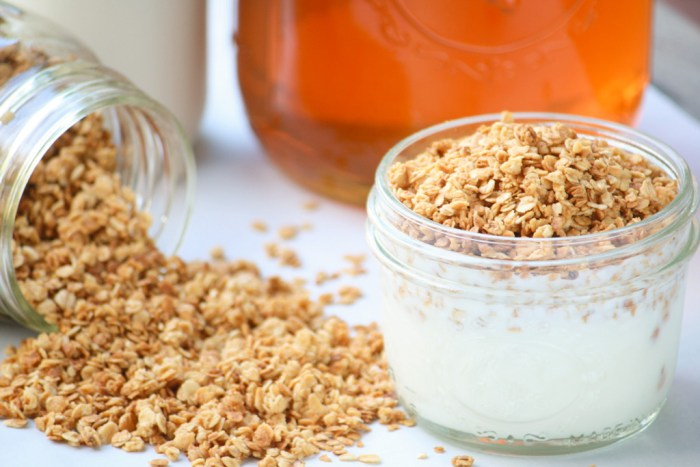 mason jar with yogurt and top with granola