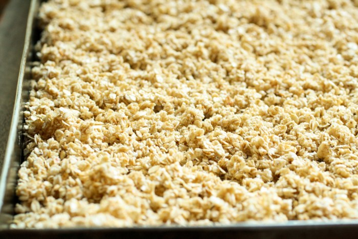 uncooked granola in a baking tray