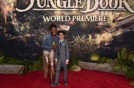 """HOLLYWOOD, CALIFORNIA - APRIL 04: Actors Lupita Nyong'o and Neel Sethi attend The World Premiere of Disney's """"THE JUNGLE BOOK"""" at the El Capitan Theatre on April 4, 2016 in Hollywood, California. (Photo by Alberto E. Rodriguez/Getty Images for Disney) *** Local Caption *** Neel Sethi; Lupita Nyong'o"""