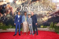 """HOLLYWOOD, CALIFORNIA - APRIL 04: (L-R) Actors Ritesh Rajan, Lupita Nyong'o, Neel Sethi and Ben Kingsley attend The World Premiere of Disney's """"THE JUNGLE BOOK"""" at the El Capitan Theatre on April 4, 2016 in Hollywood, California. (Photo by Jesse Grant/Getty Images for Disney) *** Local Caption *** Neel Sethi; Lupita Nyong'o; Ritesh Rajan; Ben Kingsley"""