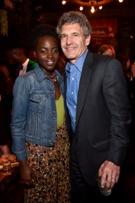 """HOLLYWOOD, CALIFORNIA - APRIL 04: Actress Lupita Nyong'o (L) and Chairman of the Walt Disney Studios, Alan Horn attend The World Premiere of Disney's """"THE JUNGLE BOOK"""" at the El Capitan Theatre on April 4, 2016 in Hollywood, California. (Photo by Alberto E. Rodriguez/Getty Images for Disney) *** Local Caption *** Lupita Nyong'o; Alan Horn"""