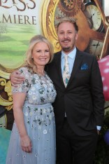 """Suzanne Todd and James Bobin pose together at The US Premiere of Disney's """"Alice Through the Looking Glass"""" at the El Capitan Theater in Los Angeles, CA on Monday, May 23, 2016. .(Photo: Alex J. Berliner/ABImages)"""