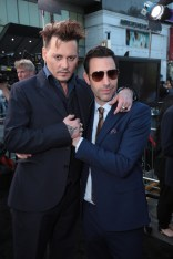 """Johnny Depp and Sacha Baron Cohen pose together at The US Premiere of Disney's """"Alice Through the Looking Glass"""" at the El Capitan Theater in Los Angeles, CA on Monday, May 23, 2016. .(Photo: Alex J. Berliner/ABImages)"""