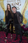 """Jessica Miller and Lars Ulrich arrive at The US Premiere of Disney's """"Alice Through the Looking Glass"""" at the El Capitan Theater in Los Angeles, CA on Monday, May 23, 2016. .(Photo: Alex J. Berliner/ABImages)"""