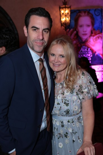 """Sacha Baron Cohen and Suzanne Todd pose together at the after-party at The US Premiere of Disney's """"Alice Through the Looking Glass"""" at the El Capitan Theater in Los Angeles, CA on Monday, May 23, 2016. .(Photo: Alex J. Berliner/ABImages)"""