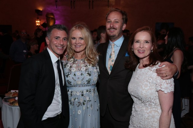 """Ricky Strauss, Suzanne Todd, James Bobin, Jennifer Todd pose together at the after-party at The US Premiere of Disney's """"Alice Through the Looking Glass"""" at the El Capitan Theater in Los Angeles, CA on Monday, May 23, 2016. .(Photo: Alex J. Berliner/ABImages)"""