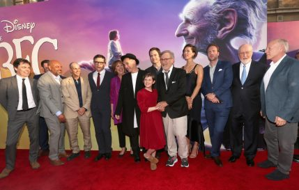 """HOLLYWOOD, CA - JUNE 21: (L-R) Actors Jonathan Holmes, Paul Moniz de Sa, Daniel Bacon, Chris Gibbs, Jemaine Clement, Penelope Wilton, Mark Rylance, Ruby Barnhill, Bill Hader, director Steven Spielberg, actors Rebecca Hall, Rafe Spall, composer John Williams and producer Frank Marshall arrive on the red carpet for the US premiere of Disney's """"The BFG,"""" directed and produced by Steven Spielberg. A giant sized crowd lined the streets of Hollywood Boulevard to see stars arrive at the El Capitan Theatre. """"The BFG"""" opens in U.S. theaters on July 1, 2016, the year that marks the 100th anniversary of Dahl's birth, at the El Capitan Theatre on June 21, 2016 in Hollywood, California. (Photo by Jesse Grant/Getty Images for Disney) *** Local Caption *** Jonathan Holmes; Paul Moniz de Sa; Daniel Bacon; Chris Gibbs; Jemaine Clement; Penelope Wilton; Mark Rylance; Ruby Barnhill; Bill Hader; Steven Spielberg; Rebecca Hall; Rafe Spall; John Williams; Frank Marshall"""