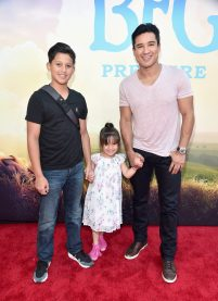 """HOLLYWOOD, CA - JUNE 21: TV personality Mario Lopez (R) and daughter Gia Francesca Lopez (C) and guest arrive on the red carpet for the US premiere of Disney's """"The BFG,"""" directed and produced by Steven Spielberg. A giant sized crowd lined the streets of Hollywood Boulevard to see stars arrive at the El Capitan Theatre. """"The BFG"""" opens in U.S. theaters on July 1, 2016, the year that marks the 100th anniversary of Dahl's birth, at the El Capitan Theatre on June 21, 2016 in Hollywood, California. (Photo by Alberto E. Rodriguez/Getty Images for Disney) *** Local Caption *** Mario Lopez; Gia Francesca Lopez"""