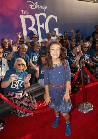"""HOLLYWOOD, CA - JUNE 21: Actress Aubrey Anderson-Emmons arrives on the red carpet for the US premiere of Disney's """"The BFG,"""" directed and produced by Steven Spielberg. A giant sized crowd lined the streets of Hollywood Boulevard to see stars arrive at the El Capitan Theatre. """"The BFG"""" opens in U.S. theaters on July 1, 2016, the year that marks the 100th anniversary of Dahl's birth, at the El Capitan Theatre on June 21, 2016 in Hollywood, California. (Photo by Jesse Grant/Getty Images for Disney) *** Local Caption *** Aubrey Anderson-Emmons"""
