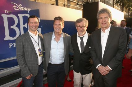"""HOLLYWOOD, CA - JUNE 21: (L-R) Amblin Partner President and Co-CEO Jeff Small, CEO, Amblin Partners, Michael Wright, director Steven Spielberg and Chairman, The Walt Disney Studios, Alan Horn arrive on the red carpet for the US premiere of Disney's """"The BFG,"""" directed and produced by Steven Spielberg. A giant sized crowd lined the streets of Hollywood Boulevard to see stars arrive at the El Capitan Theatre. """"The BFG"""" opens in U.S. theaters on July 1, 2016, the year that marks the 100th anniversary of Dahl's birth, at the El Capitan Theatre on June 21, 2016 in Hollywood, California. (Photo by Jesse Grant/Getty Images for Disney) *** Local Caption *** Jeff Small; Michael Wright; Steven Spielberg; Alan Horn"""
