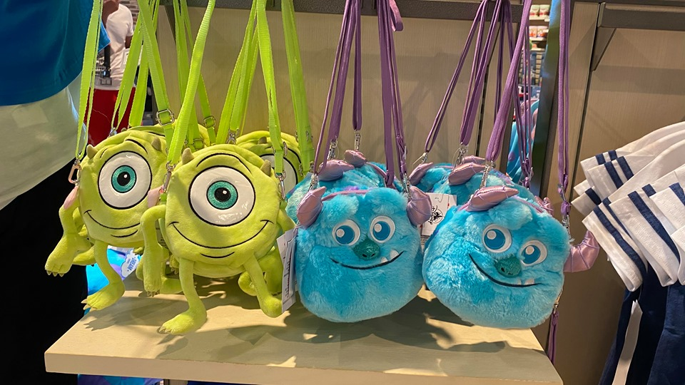 We're Screaming For These Monsters INC Purses At Disney Springs