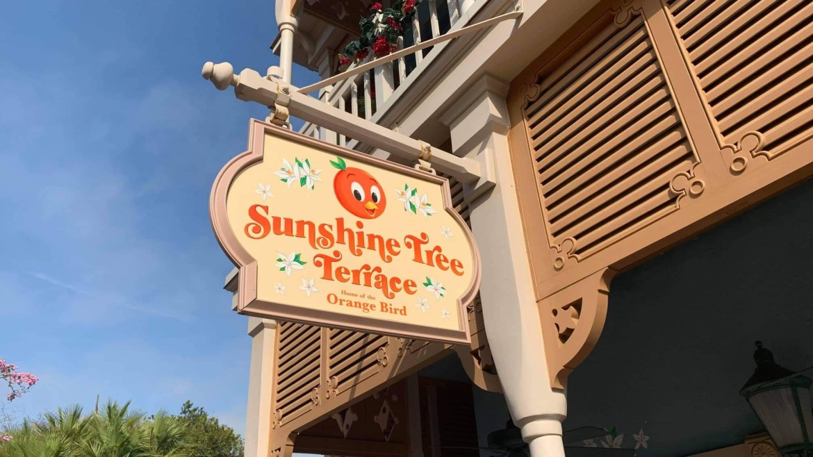 Sunshine Tree Terrace gets a new sign to go with new mural