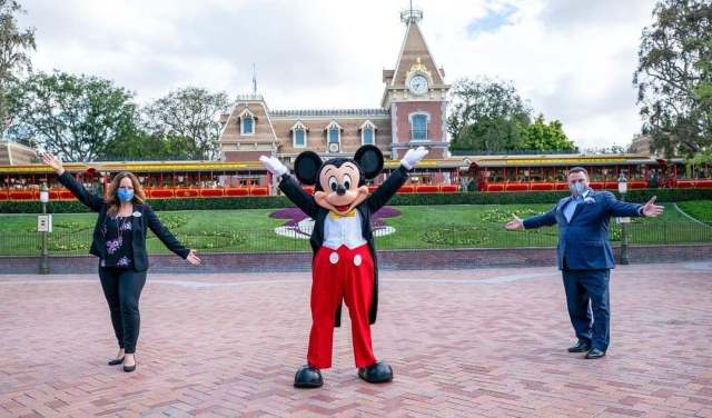 Mickey Mouse opens the gates and welcome guests back to Disneyland 1