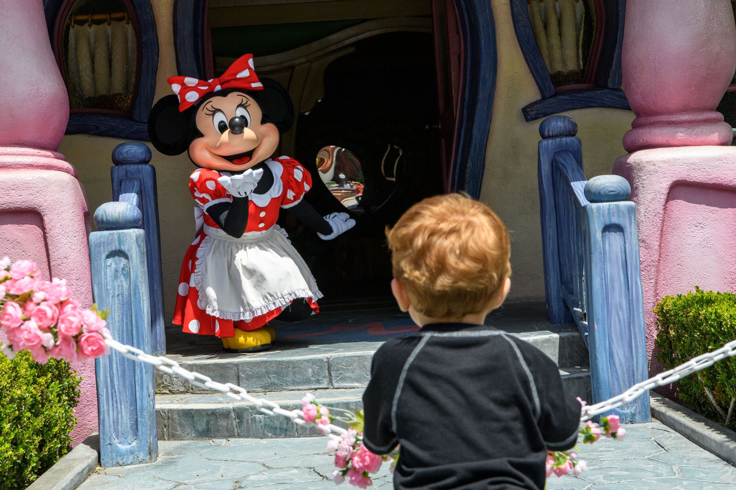 Disney characters welcome guests back to the Disneyland Resort! 3
