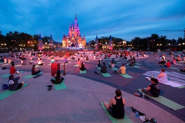 Disney Cast Members participate in Sunrise Yoga once again in the Magic Kingdom 1