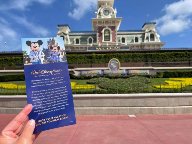 Disney handing out information about upcoming fastpass changes 3