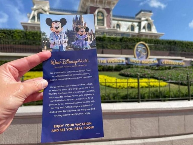 Disney handing out information about upcoming fastpass changes 1