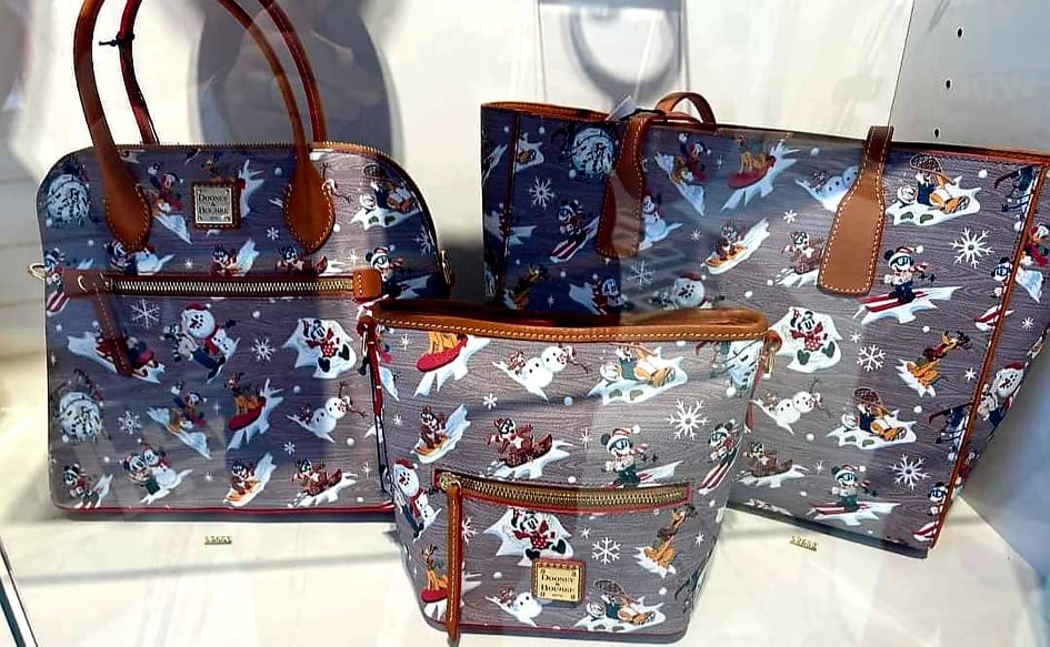 The New Disney Holiday Dooney And Bourke Collection is A Winter Wonderland Of Style