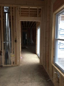 Looking from the master bedroom to the hallway that leads to the kitchen