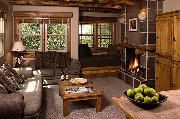 Colorado honeymoon 302 One Bedroom A cozy living room that is well-ventilated surrounded with wide windows
