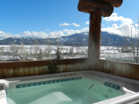 A perfectly warm Jacuzzi in a snowy environment