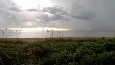 A peaceful Naples beach close to sunset