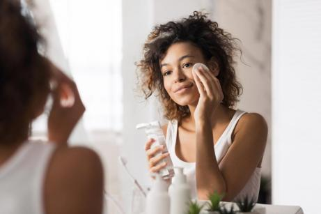 young woman using face cleanser for black skin care fun Ways to Exercise