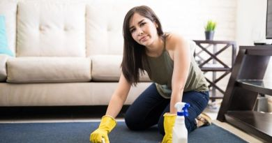 0 Upset and tired woman cleaning carpet at home filter change