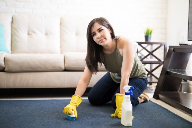 0 Upset and tired woman cleaning carpet at home how to Get Rid of Old Carpet Stains