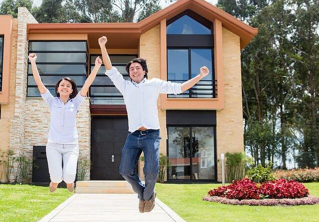 Excited couple jumping after buying a house Make Your Dream Home