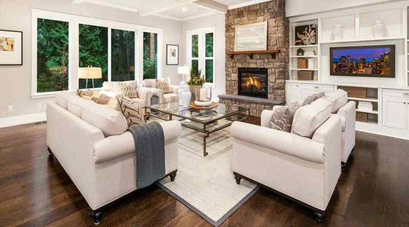 living room with dark hardwood flooring stone fireplace and box ceiling Contemporary Flooring Options