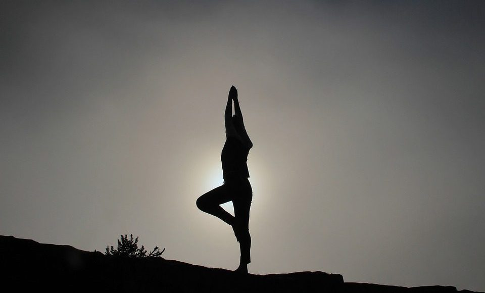 silhouette yoga standing pose