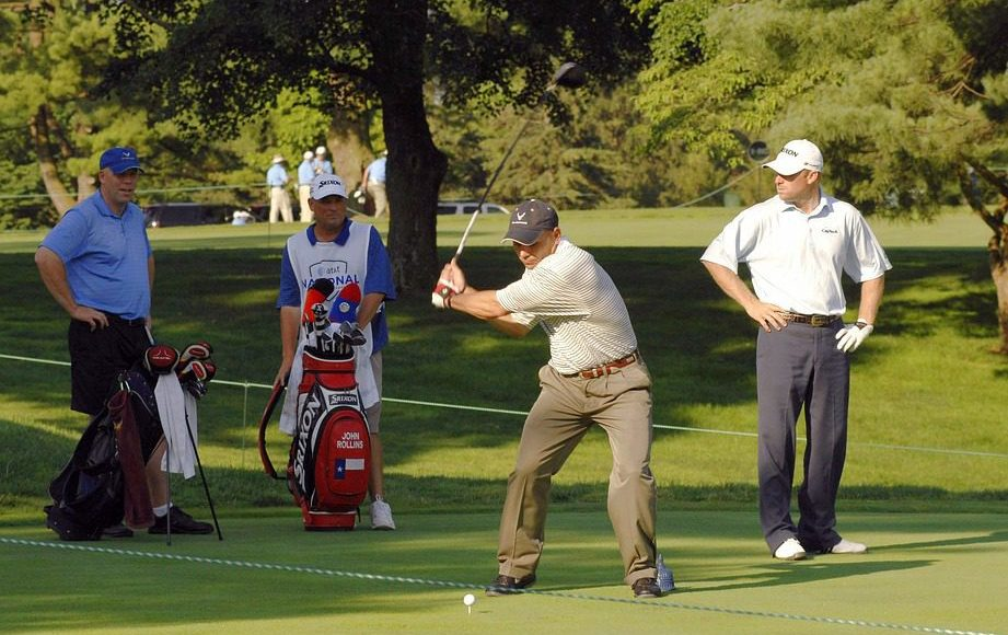 golfers playing a round
