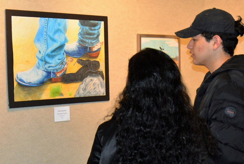 Visitors admire art work from area high school students at the 2019 Bosque Arts Center High School Student Art show.