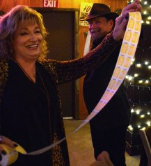 Kathy Ryder sells stretch raffle tickets to Chisholm Country.com's Managing Director Brett Voss at the 50th Annual Clifton Chamber Banquet Saturday.