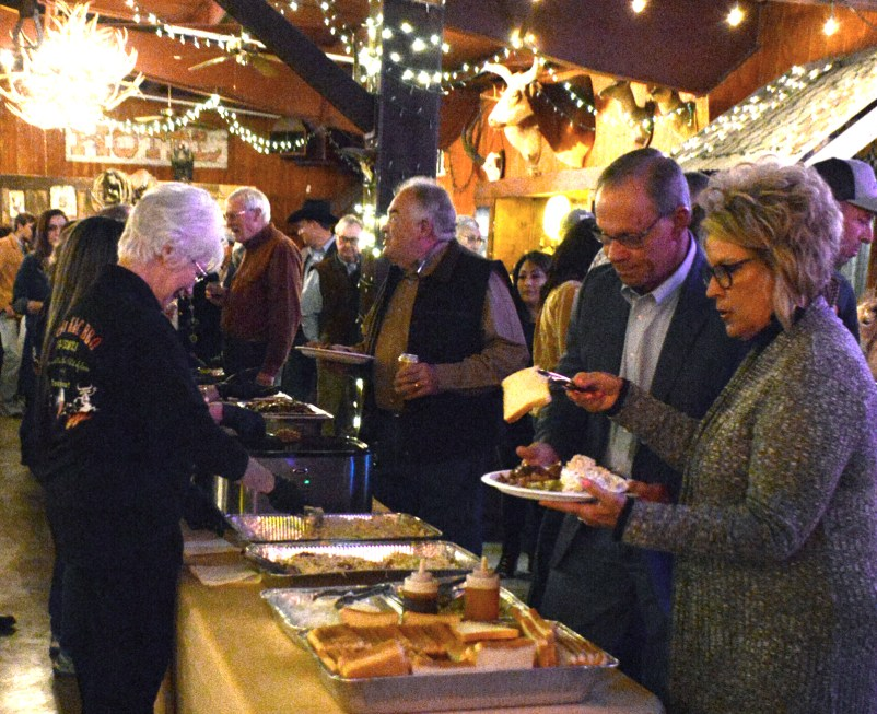 Visitors to the 50th Annual Clifton Chamber Banquet Saturday enjoy the barbecue meal catered by Rockin' K&C BBQ.