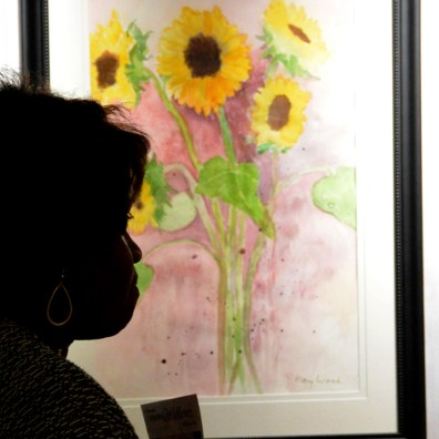 Visitors admire the Bosque Museum Wildflower Art Show & Sale pieces.
