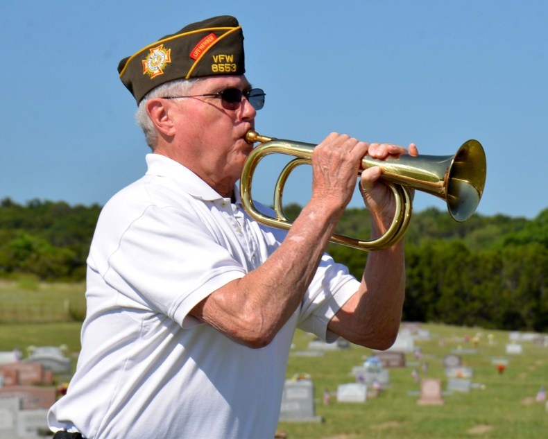 Bugler Veteran Kenny Birdwood offers Taps at a Memorial Day Ceremony in Clifton.