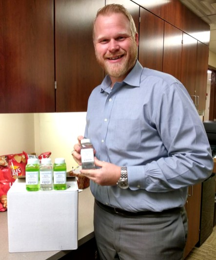 Goodall-Witcher Healthcare President and CEO Adam Willmann accepts a donated box of hand sanitizer from Gary McKibben and produced at the Red Caboose Winery & Distillery.