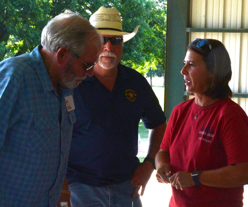 Bosque County Judge Don Pool speaks with Bosque County Clerk Tab Ferguson and her husband Scott at the Bosque County Republican Club Party in the Park event June 16.