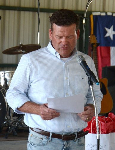 "Texas Representative DeWayne Burns reads Sherrod Fielden's poem, ""Red, White and True"" at the Bosque County Republican Club Party in the Park event June 16."
